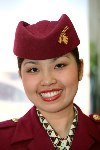 Stock Photo: 4286-62612 Stewardess of Qatar Airways in Uniform