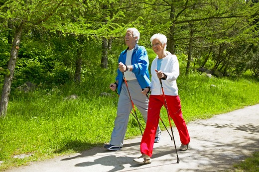 Stock Photo: 4286-62707 couple nordic walking seniors
