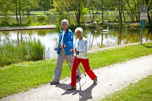 Stock Photo: 4286-62709 couple nordic walking seniors