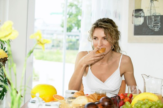 Stock Photo: 4286-63037 woman at breakfast