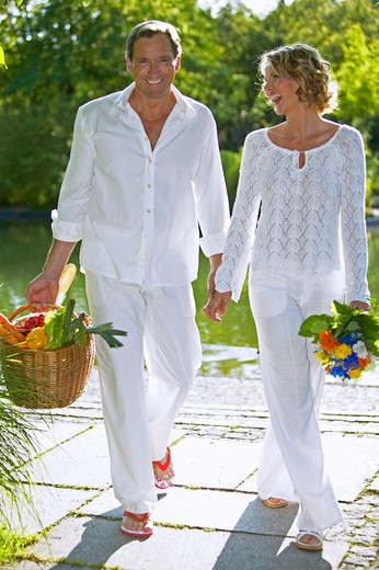 couple walking and smiling in summer : Stock Photo
