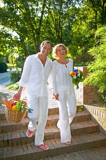 Stock Photo: 4286-63080 couple walking and smiling in summer