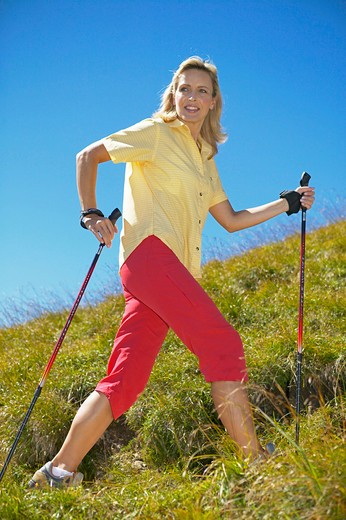 Stock Photo: 4286-63295 nordicwalking woman