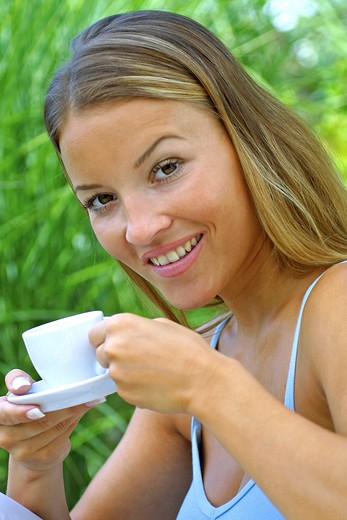 Stock Photo: 4286-63496 woman drinking coffee