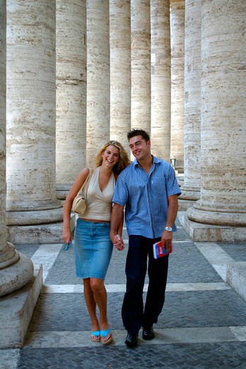 Amorous pair walking in St Peter square in Vatican city : Stock Photo