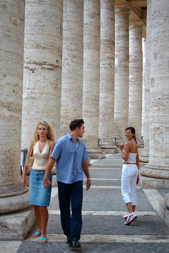 Stock Photo: 4286-63638 Young pair walking in St Peter square in Vatican city man flirting with another womansay goodbye