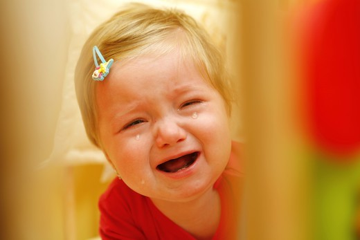 Stock Photo: 4286-64707 crying young girl