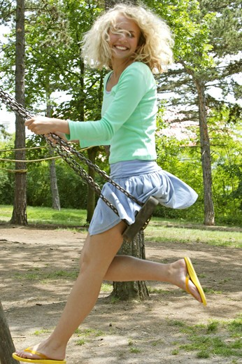 Stock Photo: 4286-65219 Girls, swing, Happily, laughter spare time, playground