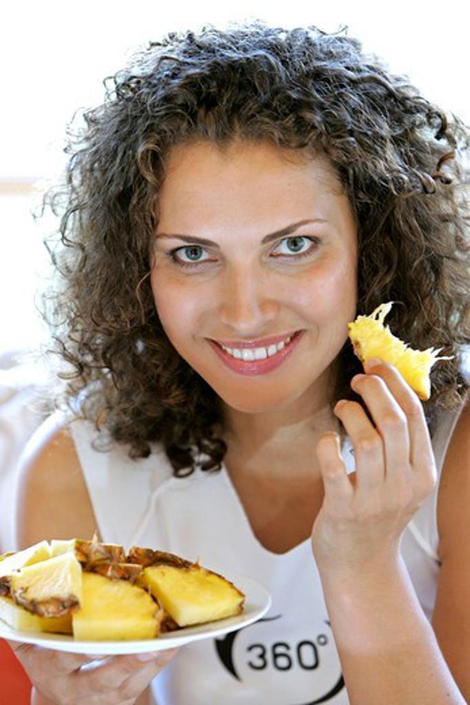 Stock Photo: 4286-65566 Woman eats fruit