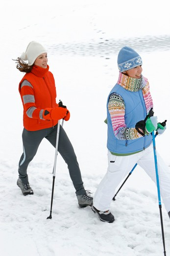 Nordic walking in winter : Stock Photo