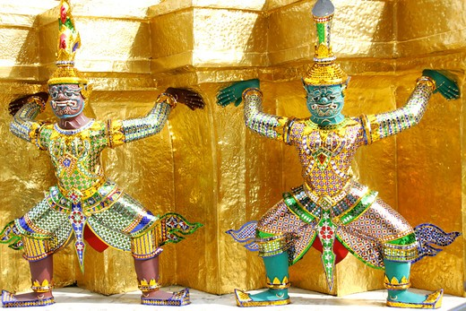 Stock Photo: 4286-66395 Bangkok figures in gilt Stupas in the Grand Palace