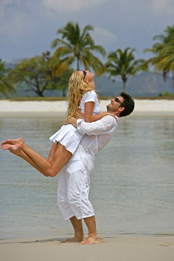 Stock Photo: 4286-66685 couple in love have fun at tropical beach in