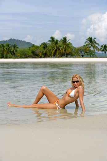 Stock Photo: 4286-66690 Sexy blond woman relax on tropical beach in