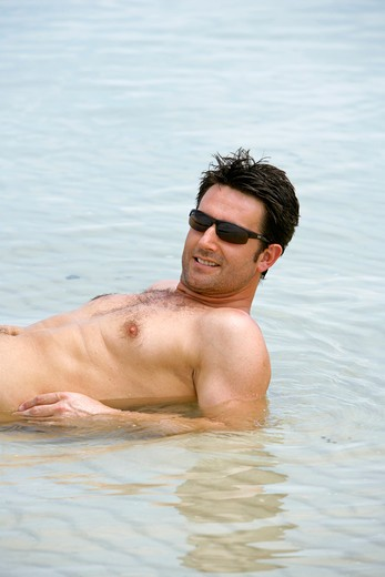 Stock Photo: 4286-66692 Man relax at tropical beach in