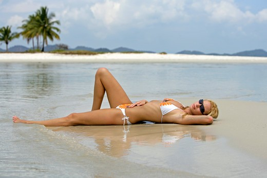 Stock Photo: 4286-66701 Sexy blond woman relax on tropical beach in
