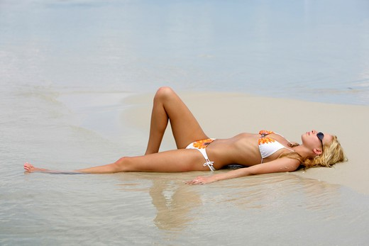 Sexy blond woman relax on tropical beach in : Stock Photo