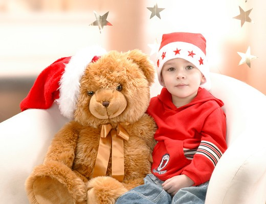Stock Photo: 4286-68196 child with teddy bear at Christmas