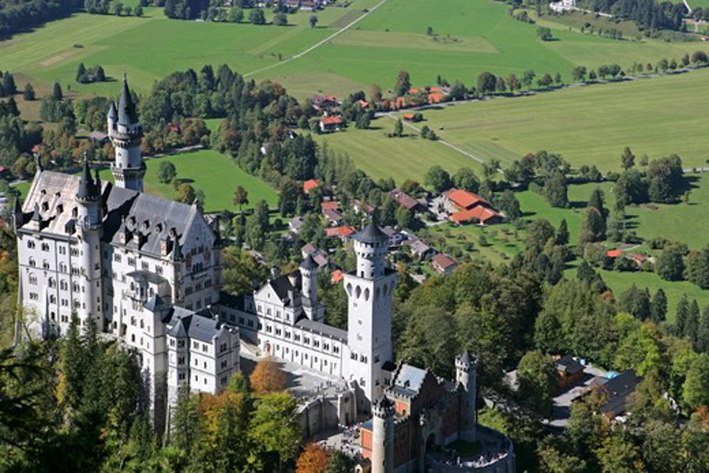 Schloss Neuschwanstein fairytale castle built by King Ludwig II near Fussen Bavaria Germany : Stock Photo