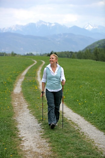 Stock Photo: 4286-68792 Blonde mature woman nordic walking