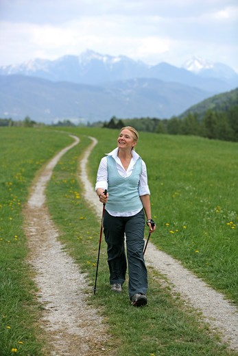 Blonde mature woman nordic walking : Stock Photo