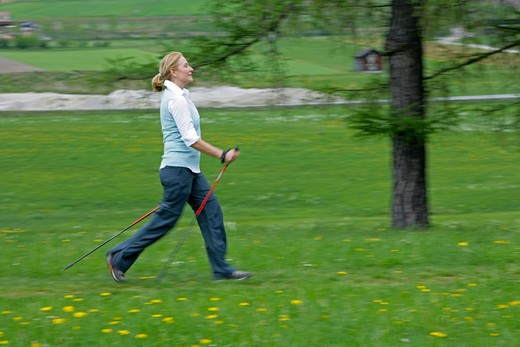 Stock Photo: 4286-68796 Blonde mature woman nordic walking