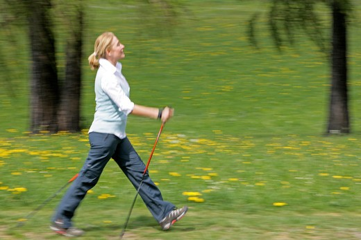 Stock Photo: 4286-68799 Blonde mature woman nordic walking
