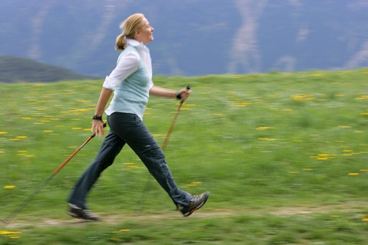 Stock Photo: 4286-68800 Blonde mature woman nordic walking