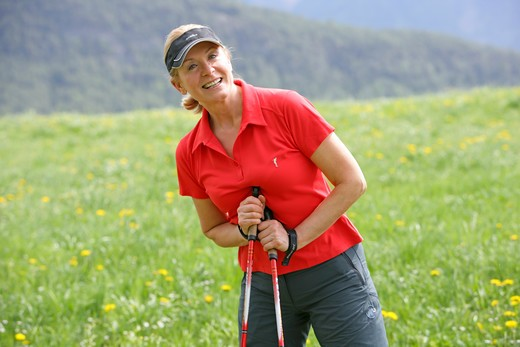 Stock Photo: 4286-68809 Blonde mature woman nordic walking