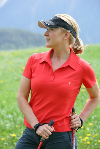 Stock Photo: 4286-68812 Blonde mature woman nordic walking