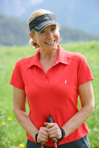 Stock Photo: 4286-68813 Blonde mature woman nordic walking