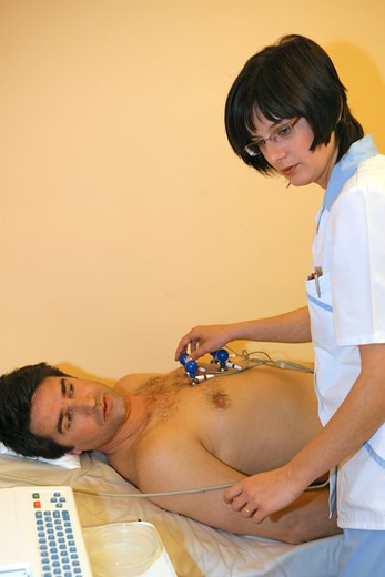 nurse giving man a ECG test : Stock Photo