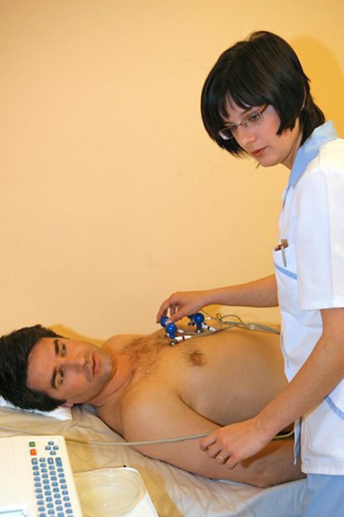Stock Photo: 4286-69353 nurse giving man a ECG test