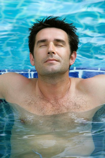 Stock Photo: 4286-69441 man relaxing on pool in summer holiday, portrait