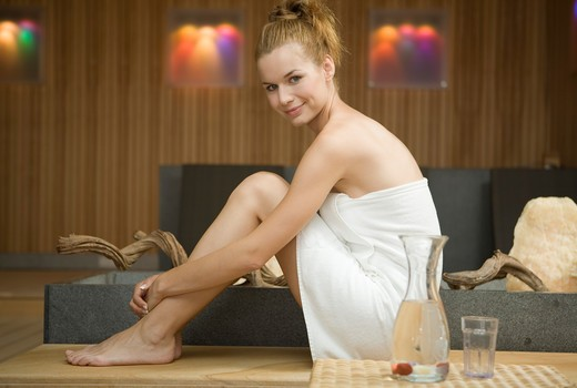 Stock Photo: 4286-70425 Young pretty woman relaxing in wellness centre.