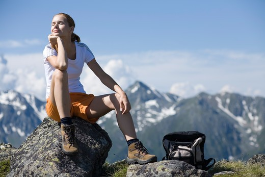 Stock Photo: 4286-70514 Young pretty woman having rest in the mountains.