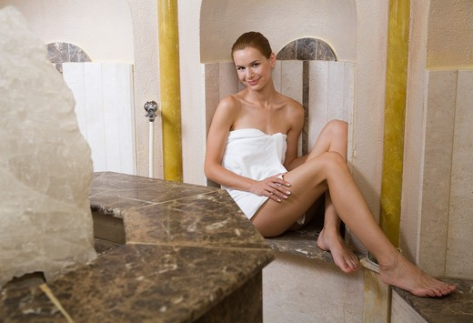 Young woman relaxing in steam sauna. : Stock Photo