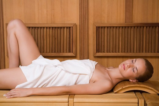 Stock Photo: 4286-70580 Young woman relaxing in sauna.