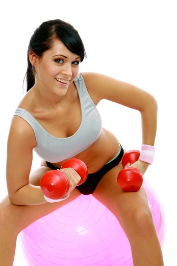 Woman exercising on a fitness ball : Stock Photo