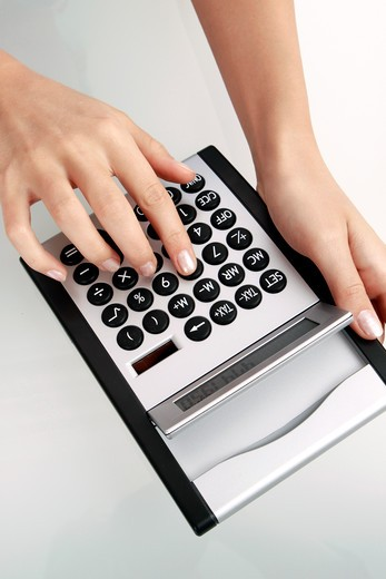 Stock Photo: 4286-71353 Woman using a calculator