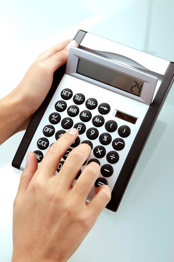 Stock Photo: 4286-71354 Woman using a calculator
