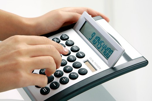 Stock Photo: 4286-71355 Woman using a calculator