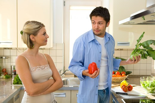 Stock Photo: 4286-71546 couple working in kitchen