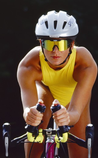 Stock Photo: 4286-72002 Woman with a racing cycle, triathlon, contest