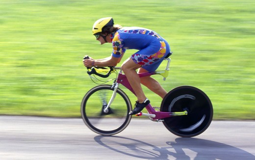 Stock Photo: 4286-72010 Man with racing cycle, triathlon contest