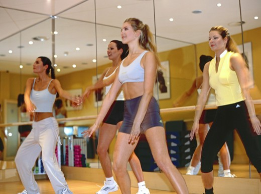 Stock Photo: 4286-72111 Young women in a fitness-center, workout