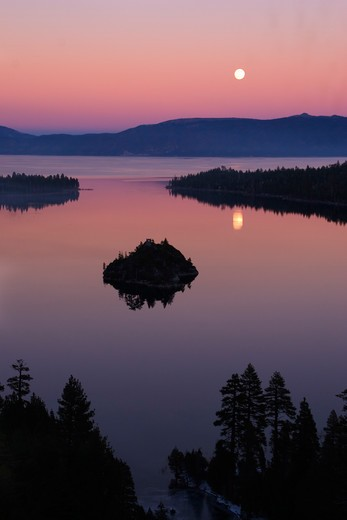 Stock Photo: 4286-72369 The full moon rising over Emerald Bay at sunset with alpenglow at Lake Tahoe California