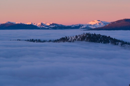Stock Photo: 4286-72385 Sunrise and a sea of clouds over Lake Tahoe and in winter in Nevada