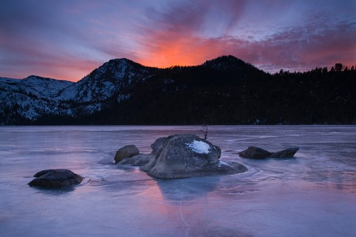 Sunset on frozen Cascade Lake near Lake Tahoe California : Stock Photo