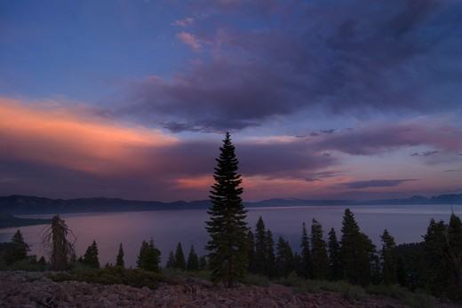Stock Photo: 4286-72650 A panorama of storm clouds breaking up over Lake Tahoe at sunset