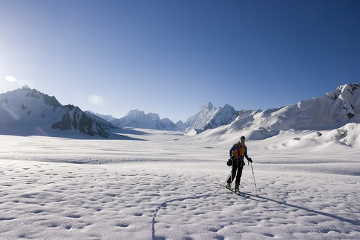 A woman ski mountaineering on the Biafo glacier in the Karakoram himalaya of Pakistan : Stock Photo